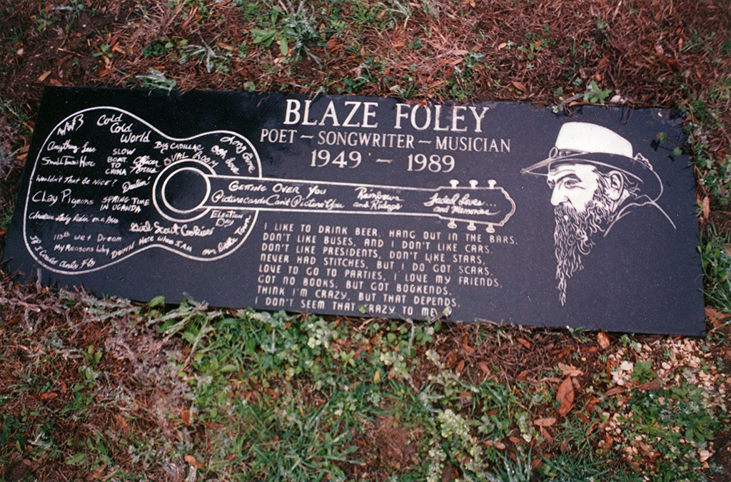 Photo of Blaze's gravestone, engraved with his guitar, song titles and profile drawing by CP Vaughn