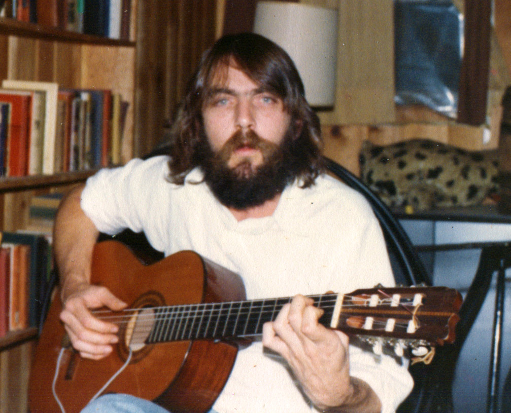 A young Depty Dawg, before he was Blaze, in beard playing guitar